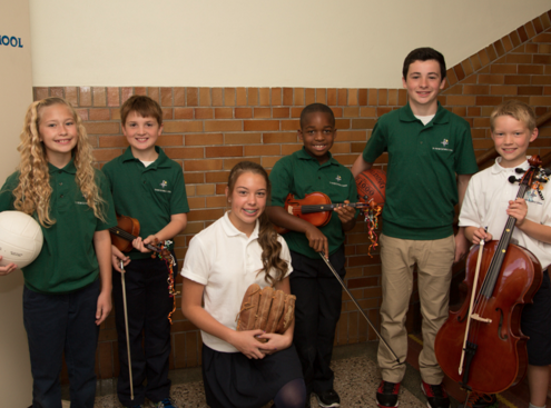 Students holding instruments and sports equipment.